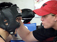 Tricia Turton, training a young boxer at Cappy's Gym