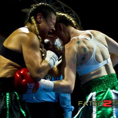 Heather Hardy with a fierce bodyshot sealing her UD against Ivana Coleman, Credit: Heather Hardy