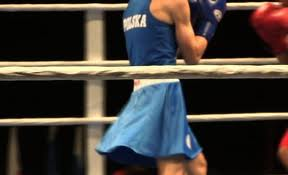 Member of the Polish National Woman's Boxing Team in a Skirt
