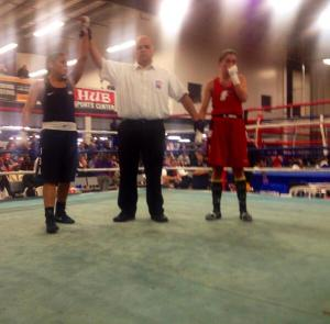 Olympian Marlen Esparza with her hand raised after her second round stoppage. Credit:  Julie Goldsticker