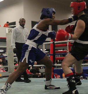 Raquel Miller throws a straigh right in the USA Boxing Semifinals. Credit: Norcalboxing.net