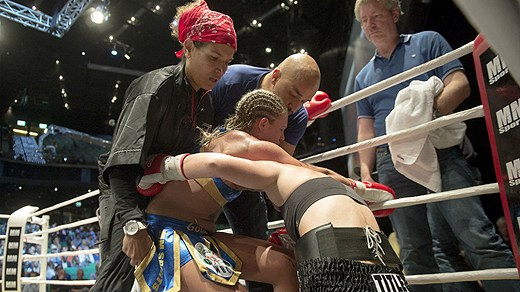 Boxer Frida Wallberg being assisted by Lucia Rijker and opponent Diana Prazak shortly after Wallberg's devastating KO loss to Prazak on 6/14/2013. Credit: Maja Suslin/Scanpix