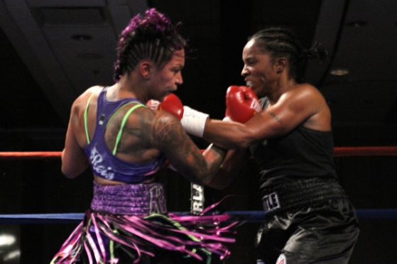 Kali Reis & Tori Nelson fight toe-to-toe during the ten-round WIBA title bout on November 7, 2013, Photo Credit: Mike Greenhill