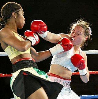 "Alicia ""Slick"" Ashley moves out of range against Elena Reid, Photo Credit: Mary Ann Owen"